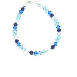 Armband, blauwe swarovski steentjes, sterling zilveren slotje (1 st.)
