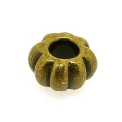 Metalen kraal, rond, antiquegoud, 6 x 12 mm, groot rijggat van ca. 4 mm (5 st.)